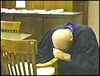 Bob Alexander prays before administering justice